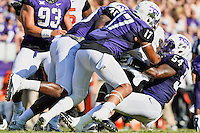 Oklahoma State tailback Tyreek Hill (24) is brought down by TCU linebacker Marcus Mallet (54), safety Sam Carter (17) and defensive end James McFarland (40) during an NCAA football game, Saturday, October 18, 2014 in Fort Worth, Tex. TCU defeated Oklahoma State 42-9. (Mo Khursheed/TFV Media via AP Images)