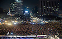 People demand President Park to step down during a rally held in Seoul