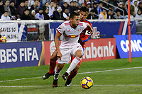 Harrison, NJ - Thursday March 01, 2018: Sean Davis, German Mejía. The New York Red Bulls defeated C.D. Olimpia 2-0 (3-1 on aggregate) during a 2018 CONCACAF Champions League Round of 16 match at Red Bull Arena.