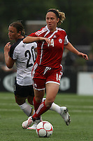 Canada's Carmelina Moscato (14) controls the ball as USWNT's Abby Wambach (20) turns to pursue. The U.S. Women's National Team defeated 1-0 in a friendly match at Marina Auto Stadium in Rochester, NY on July 19, 2009. Abby Wambach of the USWNT scored her 100th career goal in the second half..