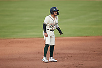 Francisco Acuna (7) of the Greensboro Grasshoppers takes his lead off of second base against the Wilmington Blue Rocks at First National Bank Field on May 25, 2021 in Greensboro, North Carolina. (Brian Westerholt/Four Seam Images)