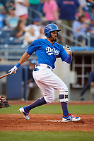 Tulsa Drillers right fielder Henry Ramos (17) follows through on a swing during a game against the Corpus Christi Hooks on June 3, 2017 at ONEOK Field in Tulsa, Oklahoma.  Corpus Christi defeated Tulsa 5-3.  (Mike Janes/Four Seam Images)