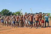 Pará State, Brazil. Aldeia Kokraimoro (Kayapo). The warriors celebrating their arrival from hunting Jabuti land tortoises for the Festa de Jabuti.
