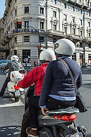 Scooters are a popular and economical mode of transportation in Rome, Italy.
