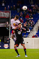 Heath Pearce (3) of the New York Red Bulls goes up for a header with Branko Boskovic (8) of D. C. United during the second leg of the MLS Eastern Conference Semifinals at Red Bull Arena in Harrison, NJ, on November 8, 2012.