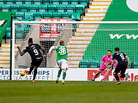 21st April 2021; Easter Road, Edinburgh, Scotland; Scottish Premiership Football, Hibernian versus Livingston; Jay Emmanuel-Thomas of Livingston pulls one back for Livingston from the penalty spot to make it 2-1 in minute 85