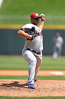 Tennessee Smokies pitcher Austin Kirk (26) delivers a pitch during a game against the Birmingham Barons on April 21, 2014 at Regions Field in Birmingham, Alabama.  Tennessee defeated Birmingham 10-5.  (Mike Janes/Four Seam Images)