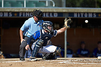 Martinsville Mustangs catcher Matthew Suggs (1) (UNC Wilmington) reaches for a pitch as home plate umpire Brian Pitts looks on during the game against the High Point-Thomasville HiToms at Finch Field on July 26, 2020 in Thomasville, NC.  The HiToms defeated the Mustangs 8-5. (Brian Westerholt/Four Seam Images)