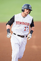 Trey Michalczewski (27) of the Kannapolis Intimidators rounds the bases after hitting a home run against the Savannah Sand Gnats at CMC-Northeast Stadium on June 9, 2014 in Kannapolis, North Carolina.  The Intimidators defeated the Sand Gnats 4-2.  (Brian Westerholt/Four Seam Images)