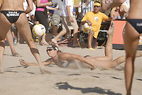Huntington Beach, CA - 5/6/07:  Misty May-Treanor dives for the ball during May-Treanor / Walsh's 21-13, 21-13 win over Branagh / Youngs in the championship match of the AVP Cuervo Gold Crown Huntington Beach Open of the 2007 AVP Crocs Tour..Photo by Carlos Delgado