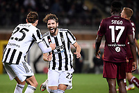Manuel Locatelli of Juventus FC (c) celebrates witth Adrien Rabiot after scoring the goal of 0-1 during the Serie A 2021/2022 football match between Torino FC and Juventus FC at Stadio Olimpico Grande Torino in Turin (Italy), October 2nd, 2021. Photo Federico Tardito / Insidefoto