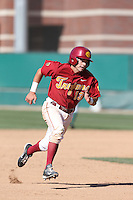 Angelo La Bruna (8) of the Southern California Trojans runs the bases during a game against the Oregon Ducks at Dedeaux Field on April 18, 2015 in Los Angeles, California. Oregon defeated Southern California, 15-4. (Larry Goren/Four Seam Images)