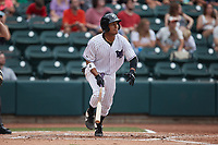 Lenyn Sosa (25) of the Winston-Salem Dash starts down the first base line against the Greensboro Grasshoppers at Truist Stadium on June 19, 2021 in Winston-Salem, North Carolina. (Brian Westerholt/Four Seam Images)