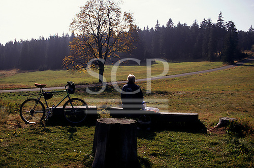 Black Mountains Nature Reserve, Czech Republic. Tourist on a cycling holiday enjoying a snack.
