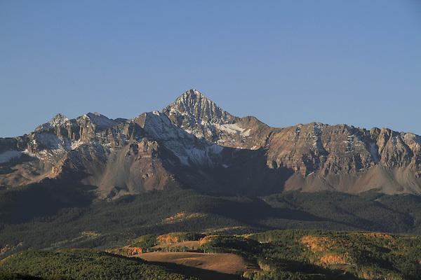 Wilson Peak with aspen trees in fall foliage,  San Juan Mountains near Telluride, Colorado, USA.