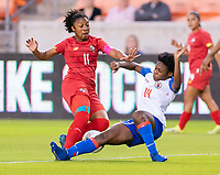 HOUSTON, TX - FEBRUARY 3: Marta Cox #11 of Panama is tackled by Phiseline Michel #14 of Haiti during a game between Panama and Haiti at BBVA Stadium on February 3, 2020 in Houston, Texas.