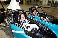 Photo: Richard Lane/Richard Lane Photography. London Wasps in Abu Dhabi for their LV= Cup game against Harlequins on 30st January 2011. 28/01/2011. Lawrence Dallaglio and Steve Hayes in a drag racing car at a raceway in Abu Dhabi.
