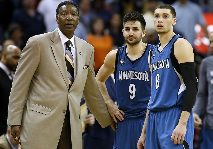 Minnesota Timberwolves head coach Sam Mitchell talks to guard Ricky Rubio (9) and guard Zach LaVine (8) during the second half of an NBA basketball game Saturday, Feb. 27, 2016, in New Orleans. The Timberwolves won 112-110. (AP Photo/Jonathan Bachman)