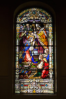 French Quarter, New Orleans, Louisiana.  St. Louis Basilica Stained Glass Window (1929) Depicting the Coronation of King Louis IX of France, 1226.