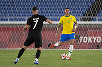 22nd July 2021; Stadium Yokohama, Yokohama, Japan; Tokyo 2020 Olympic Games, Brazil versus Germany; Diego Carlos of Brazil plays the ball through midfield past Richter of Germany