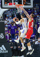 13th October 2021; Wizink Center; Madrid, Spain; Turkish Airlines Euroleague Basketball; game 3; Real Madrid versus AS Monaco; Alberto Abalde (Real Madrid Baloncesto) goes to the net despite the defense of Donatas Motiejunas  (AS Monaco)
