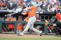 Auburn Tigers designated hitter Connor Davis (24) swings the bat during Game 4 of the NCAA College World Series against the Mississippi State Bulldogs on June 16, 2019 at TD Ameritrade Park in Omaha, Nebraska. Mississippi State defeated Auburn 5-4. (Andrew Woolley/Four Seam Images)
