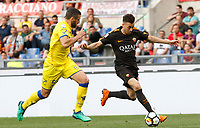 Roma s Stephan El Shaarawy, right, is challenged by Chievo Verona s Alessandro Gamberini during the Italian Serie A football match between Roma and Chievo Verona at Rome's Olympic stadium, 28 April 2018.<br /> UPDATE IMAGES PRESS/Riccardo De Luca