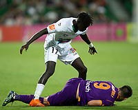 27th March 2021; HBF Park, Perth, Western Australia, Australia; A League Football, Perth Glory versus Newcastle Jets; Kuach Yuel of the Newcastle Jets stands over Bruno Fornaroli Mezza of the Perth Glory after he fouled him in a tackle