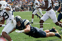 Pitt linebacker Quintin Wirginis makes a tackle. The Pitt Panthers defeated the Penn State Nittany Lions 42-39 at Heinz Field, Pittsburgh, Pennsylvania on September 10, 2016.