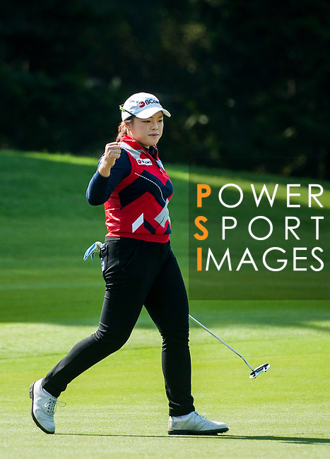 Ha-Na Jang of Korea in action during the Hyundai China Ladies Open 2014 at World Cup Course in Mission Hills Shenzhen on December 14 2014, in Shenzhen, China. Photo by Xaume Olleros / Power Sport Images