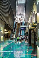 Singapore MRT Mass Rapid Transit.  Students Waiting to Board Train at Stadium Station.