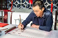 Yangzhou, Jiangsu, China.  Chinese Calligrapher at Work.