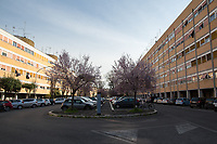 Rome, 10/03/2020. Rome's Olympic Village district under the Italian Government lockdown for the Outbreak of the Coronavirus SARS-CoV-2 - COVID-19. On the 22nd March, the Italian PM Giuseppe Conte signed a new Decree Law which suspends non-essential industry productions and contains the list of allowed working activities, which includes Pharmaceutical & food Industry, oil & gas extraction, clothes & fabric, tobacco, transports, postal & banking services (timetables & number of agencies reduced), delivery, security, hotels, communication & info services, architecture & engineer, IT manufacturers & shops, call centers, domestic personnel (1.).<br /> Updates: Italy: 22.03.20, 6:00PM: 46.638 positive cases; 7.024 recovered; 5.476 died.<br /> <br /> The Rome's Olympic Village (1957-1960) was designed by: V. Cafiero, A. Libera, A. Luccichenti, V. Monaco, L. Moretti. «Built to host the approximately 8,000 athletes involved in the 1960 Olympic Games, Rome's Olympic Village is a residential complex located between Via Flaminia, the slopes of Villa Glori and Monti Parioli. It was converted into public housing [6500 inhabitants, ndr] at the end of the sporting event. The intervention is an example of organic settlement, characterized by a strong formal homogeneity, consistent with the Modern Movement's principles of urbanism. The different architectural structures are made uniform by the use of some common elements: the pilotis, ribbon windows, concrete stringcourses, and yellow brick curtain covering. At the center of the neighborhood, the Corso Francia viaduct - a road bridge about one kilometer long - was built by Pier Luigi Nervi […]» (2.).<br /> <br /> Info about COVID-19 in Italy: http://bit.do/fzRVu (ITA) - http://bit.do/fzRV5 (ENG)<br /> 1. March 22nd Decree Law http://bit.do/fFwJn (ITA)<br /> 2. (Atlantearchitetture.beniculturali.it MiBACT, ITA - ENG) http://bit.do/fFw3H<br /> 12.03.20 Rome's Lockdown for the Outbreak of the Coronavirus SARS-CoV-2 - COVID-19 http://bit