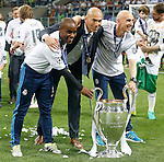 Real Madrid's coach Zinedine Zidane celebrates with his assistants the victory in the UEFA Champions League 2015/2016 Final match.May 28,2016. (ALTERPHOTOS/Acero)