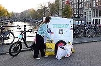 Nederland -  Amsterdam - 2020. Bakfiets van Seenons, de circulaire dienstverlener. Seenons maakt het makkelijk voor bedrijven om afval te scheiden. Vervolgens wordt dit afval op een duurzame manier opgehaald. Reststromen worden gekoppeld aan lokale bedrijven die deze circulair verwerken tot nieuwe producten. Hierbij wordt altijd gekeken naar de meest hoogwaardige verwerkingswijze. Foto : ANP/ HH / Berlinda van Dam
