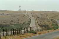 Tadzhik-Afghan frontier at P'andz, with electric barbed wire, anti personal mine, mirador and Russian military patrol.