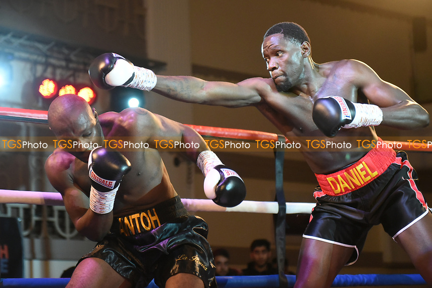 Lesther Daniel (black/red shorts) defeats Gianni Antoh during a Boxing Show at the Dunstable Conference Centre on 7th March 2020
