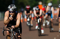 01 JUNE 2014 - LONDON, GBR - A competitor drinks an energy gel as he races on the bike course around Hyde Park in London, Great Britain during the 2014 ITU World Triathlon Series Open Olympic Distance Age Group race (PHOTO COPYRIGHT © 2014 NIGEL FARROW, ALL RIGHTS RESERVED)