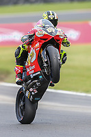 Shane Byrne of the Be Wiser Ducati team (No. 67) celebrates his second win of the day with a wheelie after victory in Race Two at the 2017 BSB Round 6 - Brands Hatch GP Circuit at Brands Hatch, Longfield, England on Sunday 23 July 2017. Photo by David Horn/PRiME Media Images