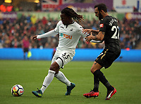 (L-R) Renato Sanches of Swansea City challenged by Jesus Gamez of Newcastle United during the Premier League match between Swansea City and Newcastle United at The Liberty Stadium, Swansea, Wales, UK. Sunday 10 September 2017