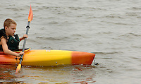 A boy tries his hand at kayaking in the Chesapeake Bay in Anne Arundel County, Maryland.