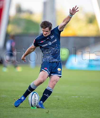 4th June 2021; AJ Bell Stadium, Salford, Lancashire, England; English Premiership Rugby, Sale Sharks versus Harlequins;  AJ MacGinty of Sale Sharks kicks a conversion to make the score 26-7 at half time
