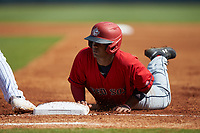 Elijha Hammill (29) of Holy Trinity HS in Oakville, ON playing for the Boston Red Sox scout team dives back into first base during the East Coast Pro Showcase at the Hoover Met Complex on August 4, 2020 in Hoover, AL. (Brian Westerholt/Four Seam Images)
