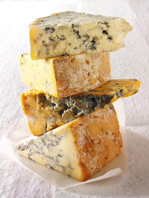 British Blue Cheese photos-From the top - Blue Vinney, Stilton, Blacksticks Blue, Creamy Stilton. Funky Stock Photos.