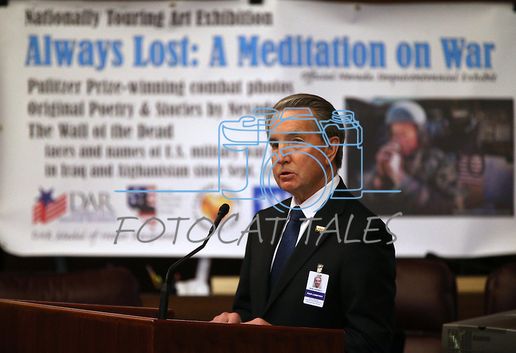 Carson City Mayor Bob Crowell speaks at the opening ceremony of the Always Lost: A Meditation on War exhibit at the Legislative Building in Carson City, Nev., on Monday, April 6, 2015. <br /> Photo by Cathleen Allison/Nevada Photo Source