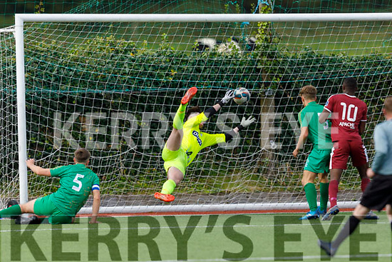 Kerry keeper Dylan Doona gets his finger tips to this Galway effort in the U19 Soccer league on Sunday