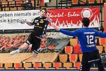 Essens Becher, Lukas gegen Ludwigshafens Martin Tomovski (Nr.12)  beim Spiel in der Handball Bundesliga, Die Eulen Ludwigshafen - Tusem Essen.<br /> <br /> Foto © PIX-Sportfotos *** Foto ist honorarpflichtig! *** Auf Anfrage in hoeherer Qualitaet/Aufloesung. Belegexemplar erbeten. Veroeffentlichung ausschliesslich fuer journalistisch-publizistische Zwecke. For editorial use only.