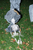 Life-sized skeletons are dressed up for Halloween decorations along Cedar Road in Belmont, Massachusetts, USA, on Mon., Oct. 30, 2017.  In this image, skeletons are seen near fake gravestones.
