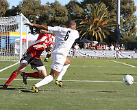 Darlington Naqbe #6 of the University of Akron pushes away from Austin Berry #24 of the University of Louisville during the 2010 College Cup final at Harder Stadium, on December 12 2010, in Santa Barbara, California. Akron champions, 1-0.