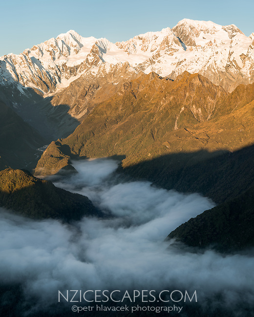 Sunset views over Southern Alps with highest peaks Aoraki Mount Cook and Mount Tasman and La Perouse with Balfour Glacier and Cook River, Westland Tai Poutini National Park, UNESCO World Heritage Area, West Coast, New Zealand, NZ